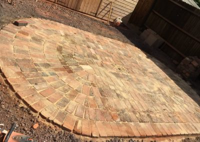 Reclaimed brick semi-circle in ash