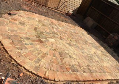 Reclaimed brick semi-circle in ash