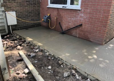 Concrete path with raised drains ready for tiling