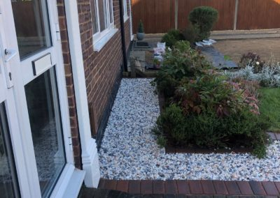 Driveway extension using flamingo decorative stones
