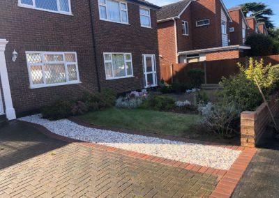 Driveway extension using flamingo decorative stones