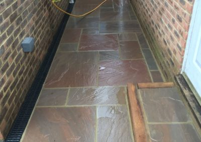 Autumn blend sandstone paving with sleeper retaining walls and drainage in Fleet