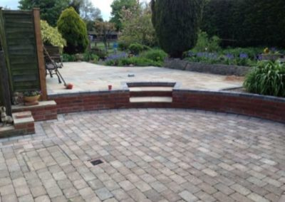 Sandstone patio with cobble style paving at Dorset